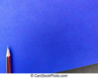 Copy space of one red color pencil with sharp lead isolated on blue background