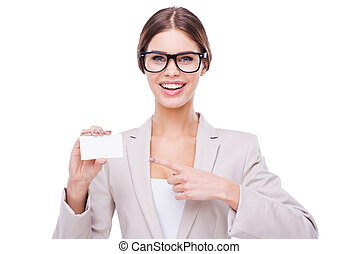 Copy space on her card. Confident businesswomen holding card and looking at camera while standing against white background