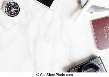 copy space on marble table with travel accessories