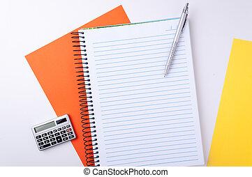 copybook, calculator and pen