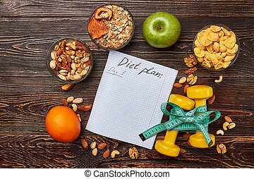 Copybook, fruits, nuts and dumbbells.