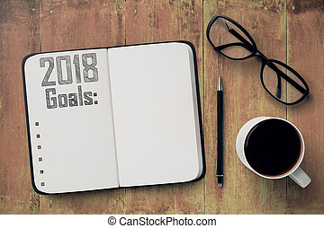 Top view of copybook with 2018 goals placed on wooden desktop. New Year's resolution concept. Mock up, 3D Rendering