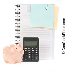 Copybook with piggy bank and calculator on isolated white background, top view