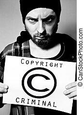 Copyright criminal - Man arrested for violating copyright...