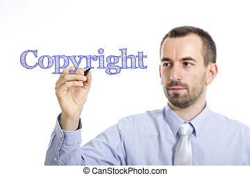 Copyright - Young businessman writing blue text on transparent surface