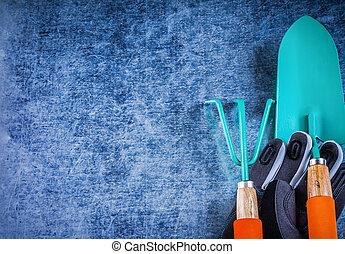 Copyspace of hand trowel metal rake gardening gloves agriculture