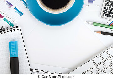 Copyspace on contemporary workplace with financial papers,...