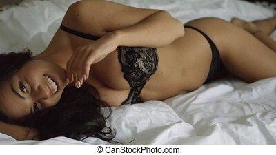 Coquettish brunette posing in underwear - Young attractive...