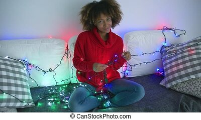 Coquettish model in sweater with twinkle lights - Amazing...