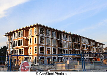 Brend new townhouse building with construction site in Coquitlam BC Canada.