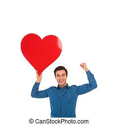 coração, amor, grande, jovem, celebrando, segurando, vermelho, homem