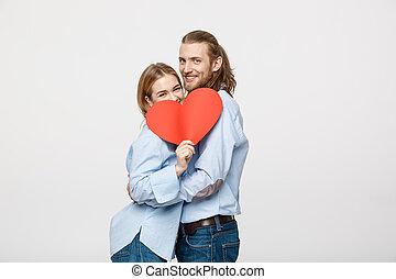 coração, conceito, amor, par, velentine, -, jovem, papel, segurando, vermelho, feliz