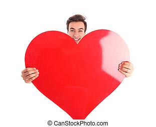 coração, grande, jovem, segurando, sorrindo, vermelho, homem
