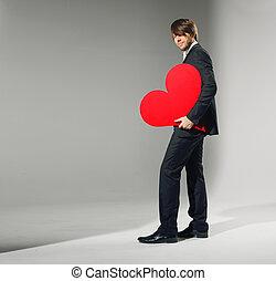 coração, homem, jovem, segurando, retrato
