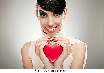 Coração, mulher, jovem, segurando