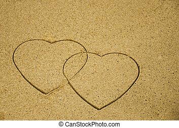 corações, areia, dois