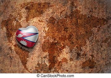 corazón, con, bandera nacional, de, nepal, en, un, vendimia, mapa del mundo, grieta, papel, fondo.