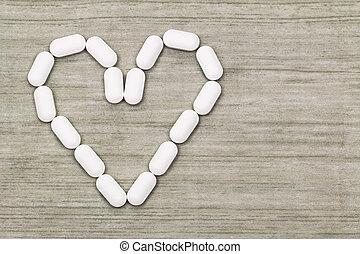 corazón, símbolo, copyspace, formado, tabletas, blanco