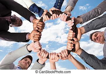 corda, grupo, businesspeople, junto, segurando