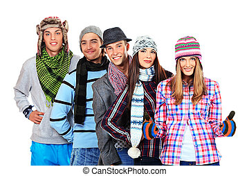 Group of cheerful young people in autumn clothes standing together. Friendship. Isolated over white.