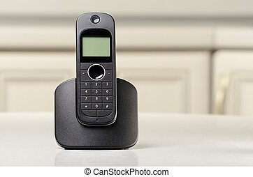 Cordless phone - Black cordless phone standing on a table