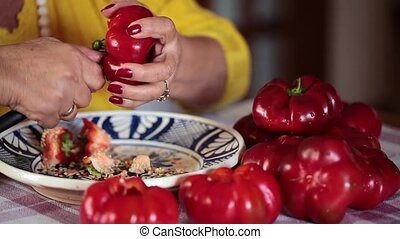 Core And Seed Tomato Peppers - Footage of woman core and...