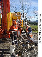 core sampling - Drilling crewmen prepare to remove a core...
