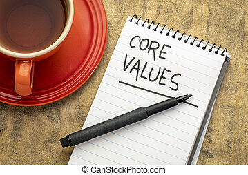 core values - handwriting in a spiral notebook with a cup of tea