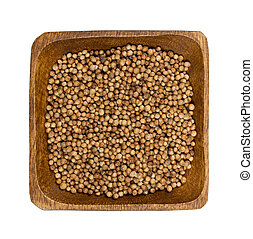 Coriander in wooden bowl isolated on white