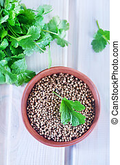 coriander in bowl and on a table