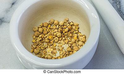 coriander seeds in a mortar
