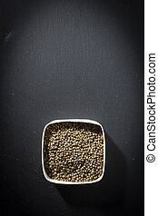 Coriander seeds in a wooden box
