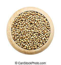 coriander seeds in a wooden dish.