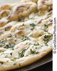 coriandolo, naan, pane aglio