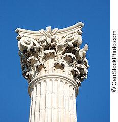 corinthian column against blue sky