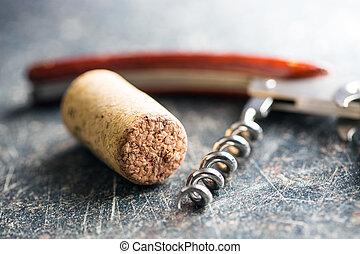 Cork and corkscrew.