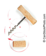 Cork and corkscrew with red wine stains
