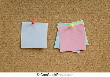 Cork board with blank paper notes for add text message