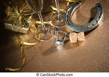 Cork from champagne bottle with a horseshoe