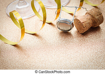 Cork from champagne bottle with streamers