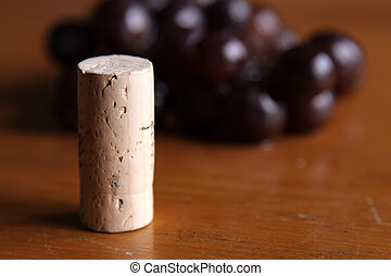 Cork in front of Grapes