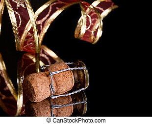 cork out of champagne and a delicate ribbon on the black