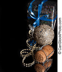 cork out of champagne ,Christmas decoration and gift on the black