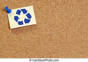 corkboard with recycle symbol on note