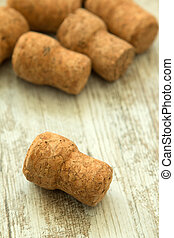 Corks from a champagne bottle on a wooden background