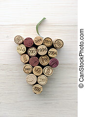 Corks in grape shape on slate - Corks in grape shape on...