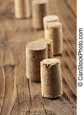 Corks on a wooden table, close up