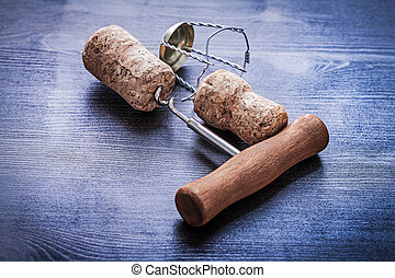 corkscrew and corks with wires of champagne