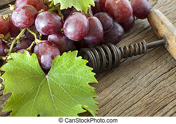 Corkscrew and grapes