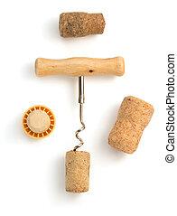 corkscrew and wine cork on white